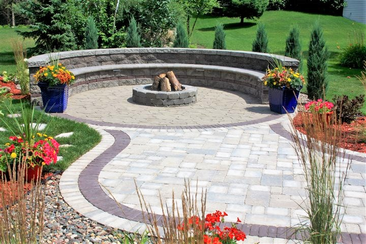 flagstone-patio-paving-with-basic-fire-pit-and-cladded-seating-with-back-rest