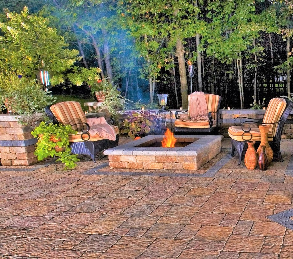 patio cobble paving installation with a square fire pit