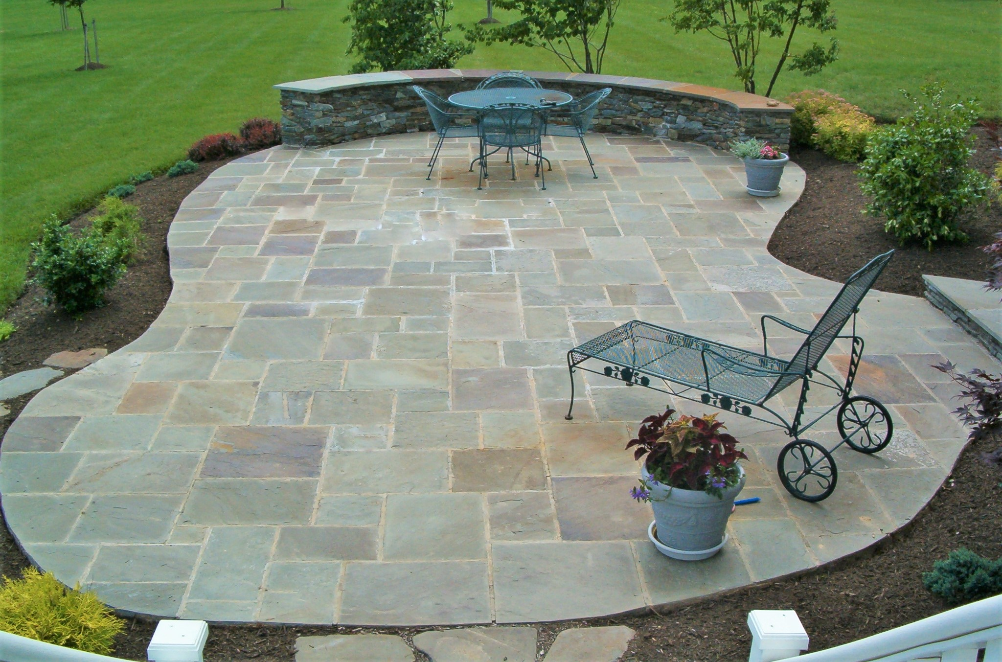 flagstone-patio-paving-with-cladded-retaining-wall