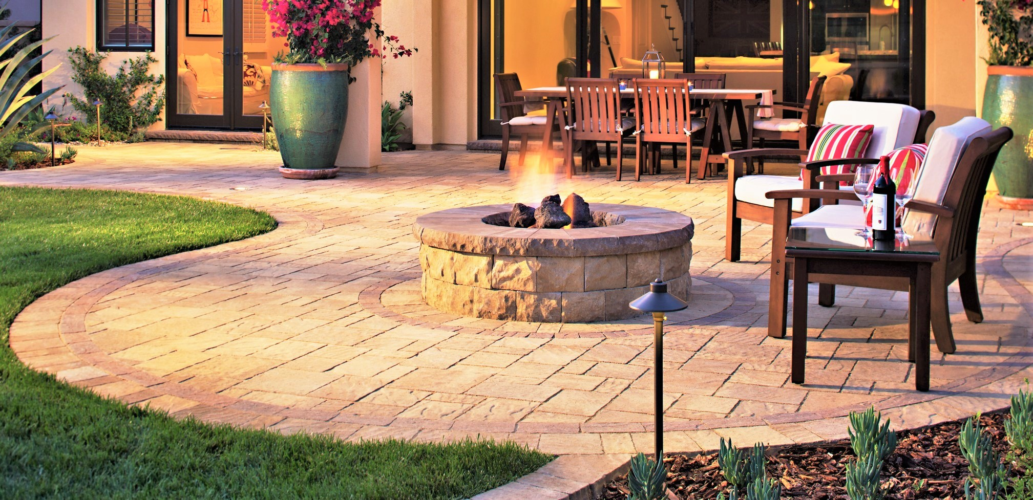 round cladded fire pit on flagstone patio