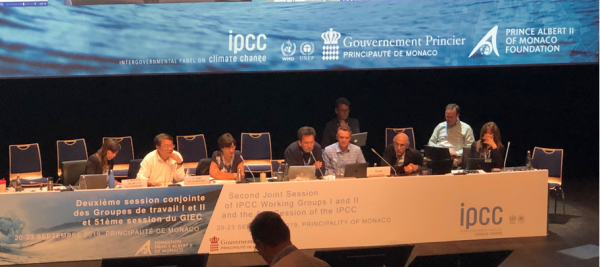 IPCC podium as authors discuss report approval