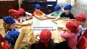 Pirates working on Math to fine treasure.