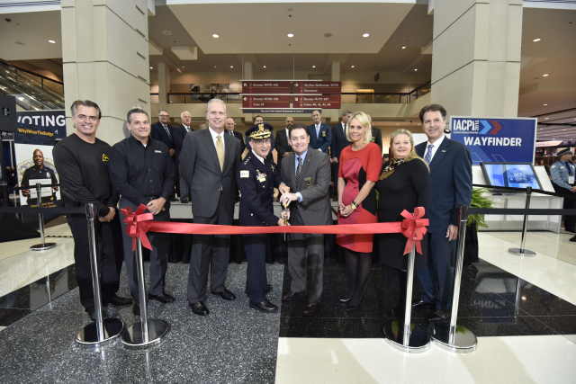 Chicago Police First Deputy Superintendent John Escalante, IACP President Richard Beary, and IACP Platinum Sponsors cut the ribbon to open the 2015 Exposition Hall.