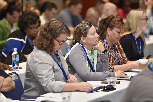 Attendees look on during a packed session on developing women leaders in law enforcement