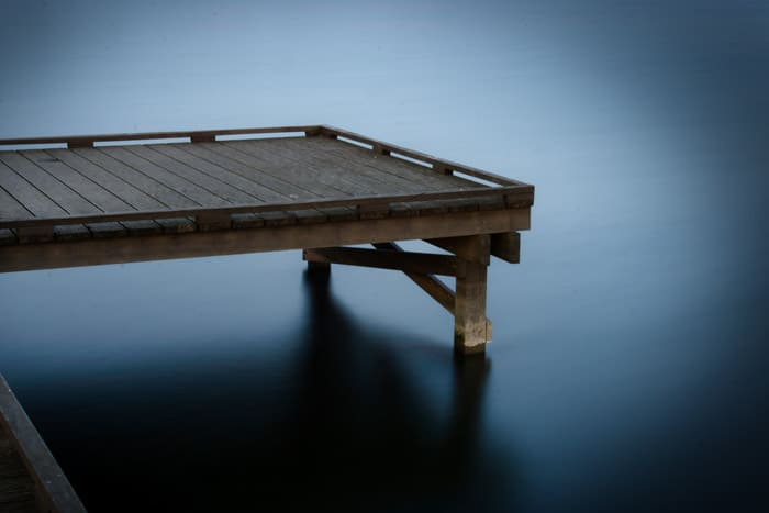 An image of a small wooden pier with vignetting occurring in the edges of the photo