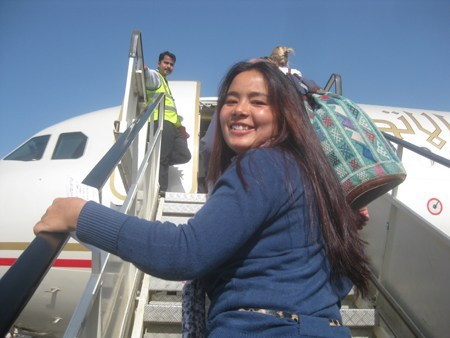 Photo of Sati smiling in Abu Dhabi as she boards the plane to Kathmandu
