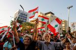 Lebanese demonstrators take part in a protest against economic conditions in Lebanon's southern city of Sidon on Monday. (Mahmoud Zayyat/AFP/Getty Images)