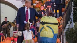Internet reacts to Trump putting candy on top of child's 'Minion' costume