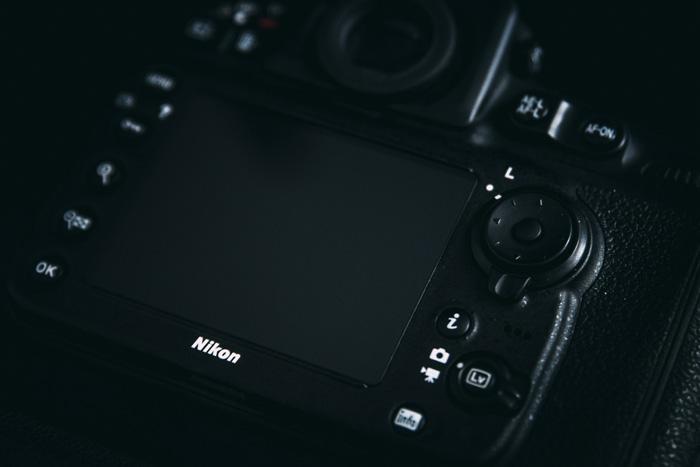 A close up of a Nikon camera - ae-l af-l