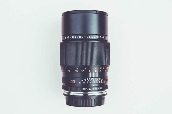 A camera lens on light background