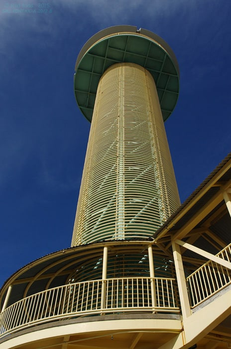 A photograph of an architectural tower against a blue sky, wavy moire pattern can be seen on the tower surface