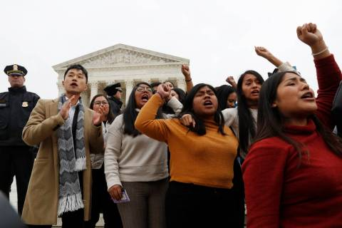 DACA recipients and others leave the Supreme Court with their hands in the air after oral argum ...
