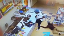 Shopper crawls to grab cash dropped by robber during hold-up