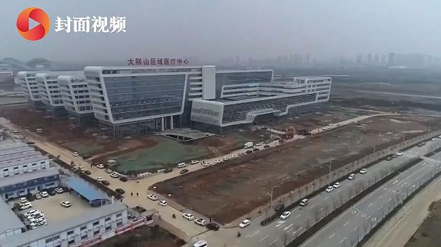 The Dabie Mountain Regional Medical Centre is the first dedicated coronavirus hospital to have opened in China. Workers and volunteers spent two days revamping an empty building