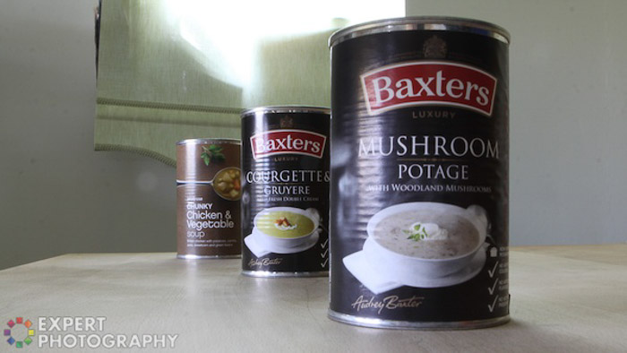 A photo of three soup cans on a table - focal length tips