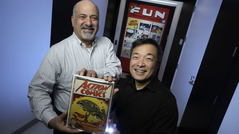 DC Comics co-publishers Dan DiDio, holding the first issue of Action Comics, and Jim Lee in 2018