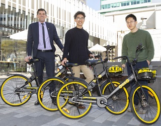 From left, Wellington Mayor Justin Lester, Harry Yang and Min-kyu Jung from Onzo with some of the bikes for hire.