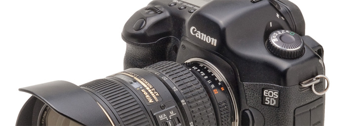 A close up of a canon DSLR using a nikon to canon lens adapter