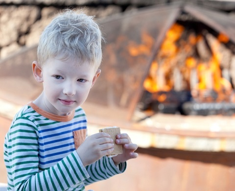 child eating smores