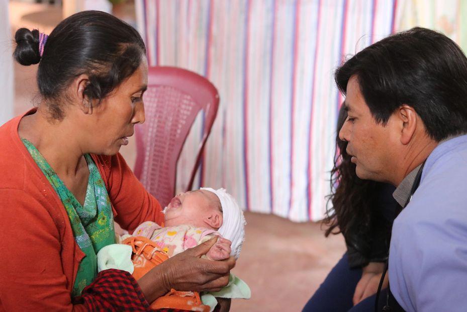 Avi Kerendian and Dr. Arash treating public health baby in  GGHTx clinic