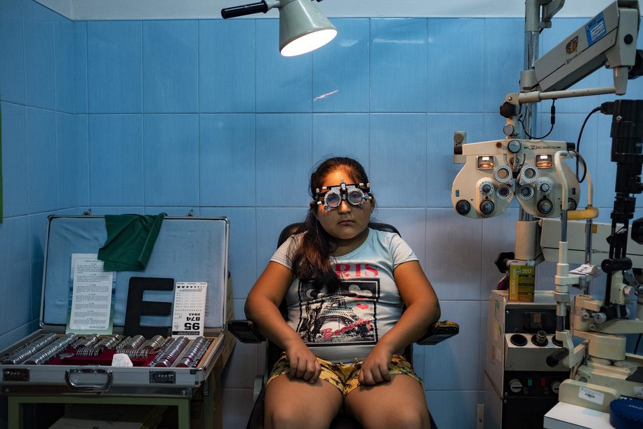 Lima - 20 March, 2018: Heidy Cordova Ramirez, 10 having her vision examination at the Maternal and Child Health Center Daniel Alcides Carrion in Villa María del Triunfo neighborhood in Lima.   In this Health Center the priority is to have an early diagnosis on eye problems, from the kids to the elderly patients. They focus in cataracts, refractive errors, prematurity retinopathy, diabetic retinopathy, glaucoma as well as external diseases of the eye.   Few years ago they even started to do their own cataract operations due the high number of patients with this pathology that they have and the over saturated health system in Lima.