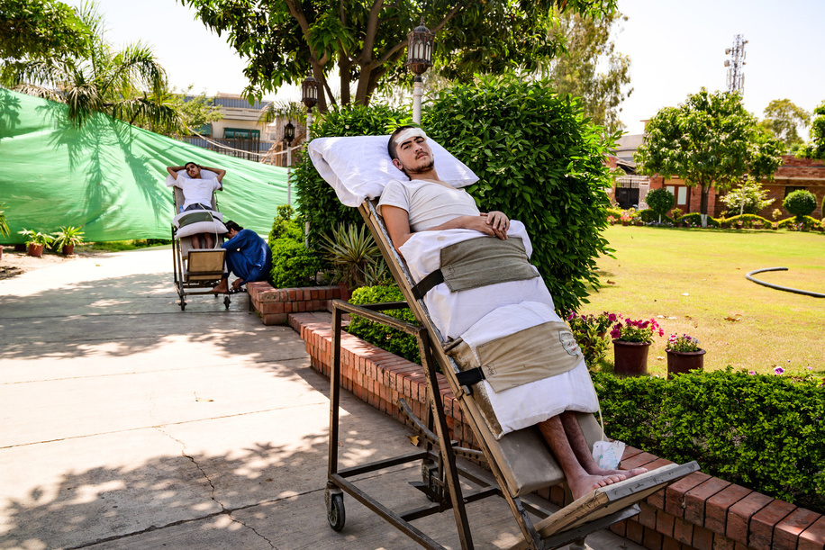 Peshawar, Pakistan - 7 May, 2019: Saad Vilah recovering in the gardens of the Paraplegic Centre of Peshawar, Pakistan. A car hit him from the back when driving a bicycle and got a  spinal cord injury.