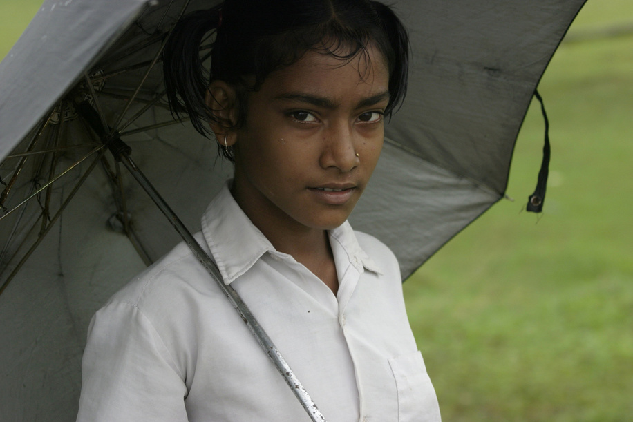 Young girl on her way home after Independence Day celebrations at school in August.