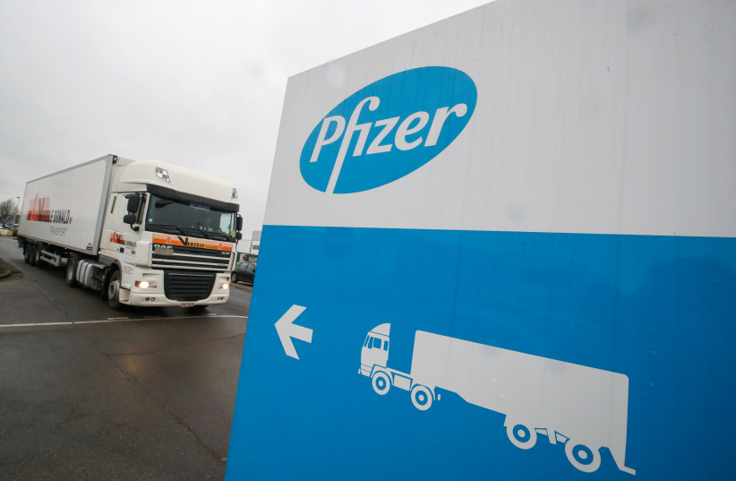 A refrigerated truck leaves the Pfizer plant in Puurs, Belgium December 3, 2020.  (photo credit: YVES HERMAN/REUTERS)