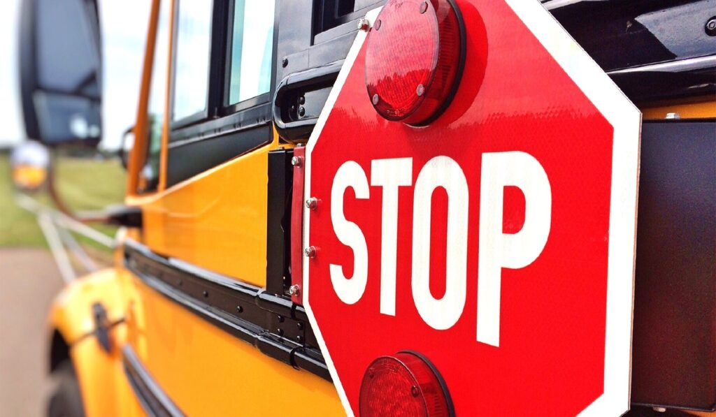 This image has an empty alt attribute; its file name is school-bus-stop-sign-1024x597.jpg