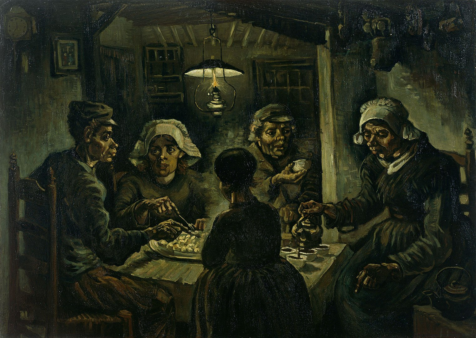 """An image of the painting by Vincent Van Gogh called """"The Potato Eaters"""". Three women and two men are shown sitting around a table eating dinner. Their faces are painted in an exaggerated way so that their chins and noses are rounded and bulbuous. They have gnarled hands and bags under their eyes. One woman, sitting at one end of the table to the far right, is pouring coffee or tea into mugs. On her right is a man looking at her and holding another mug up. Next to him is another woman who is cutting food on her plate and looking at the man next to her, who is at the far left of the painting. This man at the far left seems to be looking at the woman on the opposite end of the table or is lost in thought. He has a fork in his hand reaching out to the plate of food in front of him. There is a woman sitting to his right, with her back to the viewer. They are all sitting around a plain and rough looking table, in a room with a single light above them. The overall effect shows a fairly somber group of people sharing a very simple meal together."""