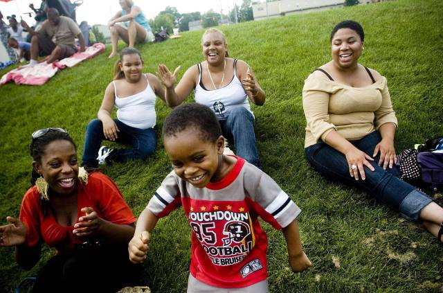Zacariah Randall, 4, dances to the music near one of the entertainment stages at the Clarissa Street Reunion at Corn Hill on Saturday afternoon in Rochester. The celebration that stretched down the neighborhood that was an early center of Rochester's African-American culture had three different stages of entertainment, food and vendors and went into the evening. (08/15/2009 - staff photo by Andrea Morales - Democrat and Chronicle)Clarissa Street Reunion