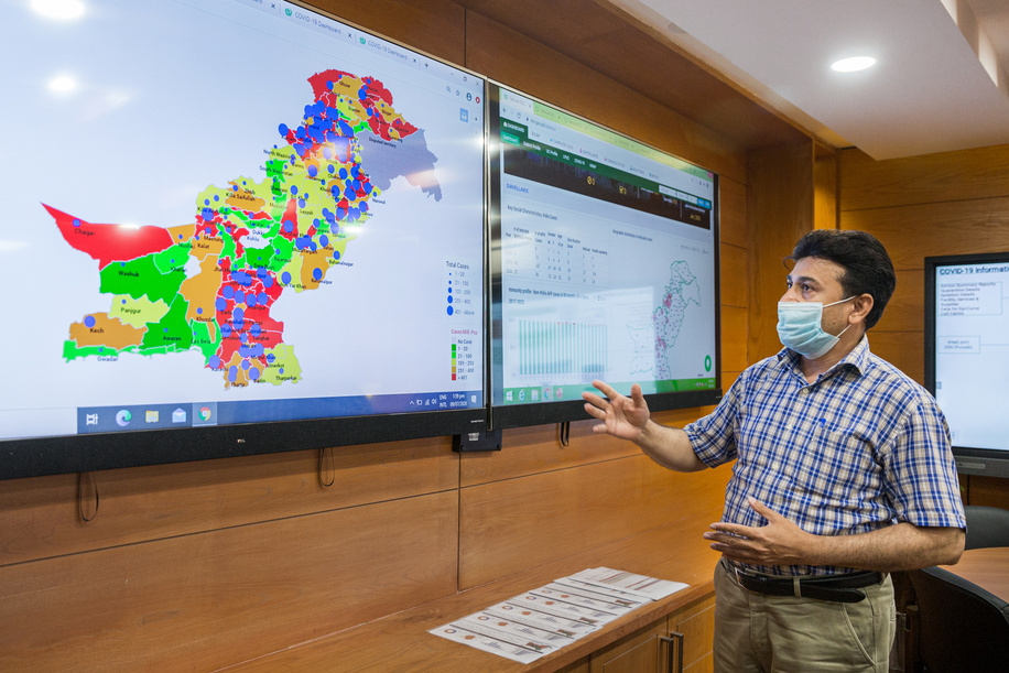 Syed Razzaq, technical officer for MIS/IT information management shows data on Pakistan's COVID-19 response at the operations room in the National Emergency Operation Centre (NEOC) for Polio Eradication, located inside the National Institute of Health.