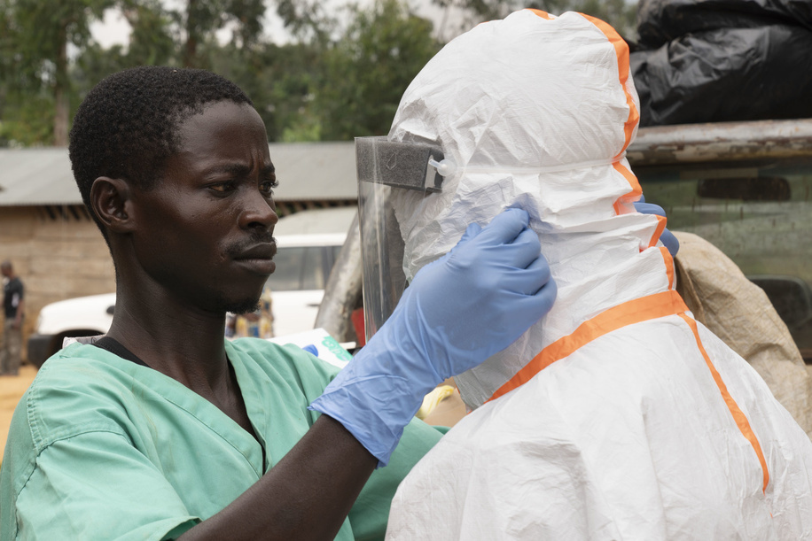 WHO's response to Ebola virus disease (EVD) outbreak in the Democratic Republic of Congo.  A disinfection team prepares Personal Protective Equipment (PPE) prior to disinfecting the home of an Ebola patient.