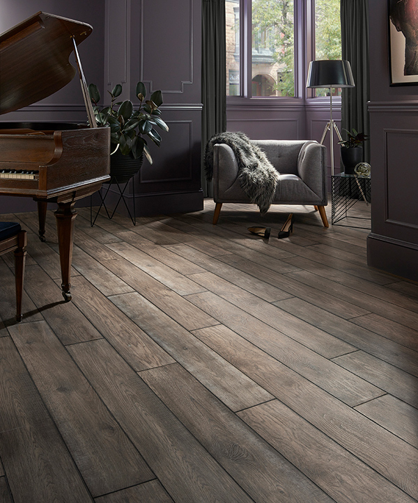A picture highlighting a 2020 themed luxury vinyl tile flooring design that incorporates a dark wood look.