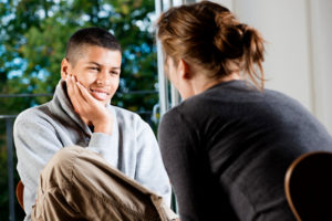 Young boy talking to therapist