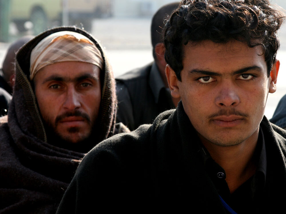 An Afghan recruit waits to be processed at the Kabul Military Training Center.