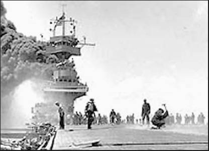 The carrier USS Yorktown takes a hit from a kamikaze plane during the Battle of Midway that began in the Pacific 64 years ago. Photo by PhoM2/C Bill Roy